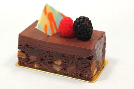 Homemade chocolate brownie cake with fresh fruit