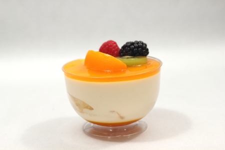 summer pudding: Delicious peach mousse in glass, white fresh fruit Stock Photo
