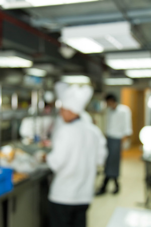 busy restaurant: Industrial kitchen of a restaurant, hotel or hospital with busy cooks working.