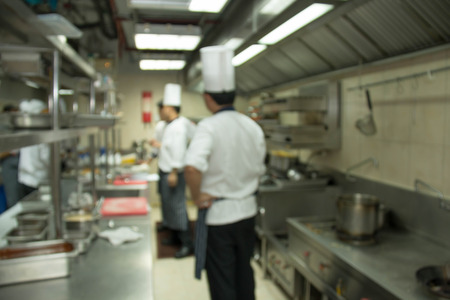 industrial kitchen: Industrial kitchen of a restaurant, hotel or hospital with busy cooks working.