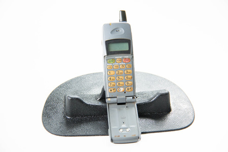 solid color background: Solid color background and shabby gray old mobile phones.