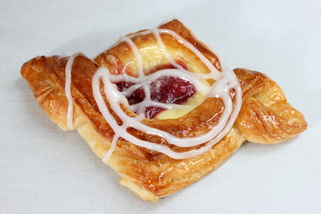 Danish pastry are made of flour, yeast, milk, eggs and butter. Stock Photo