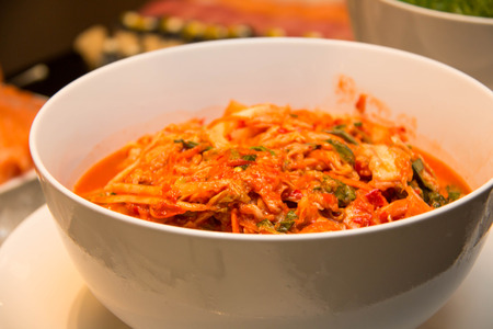 napa: A bowl of traditional Korean napa cabbage Kimchi.