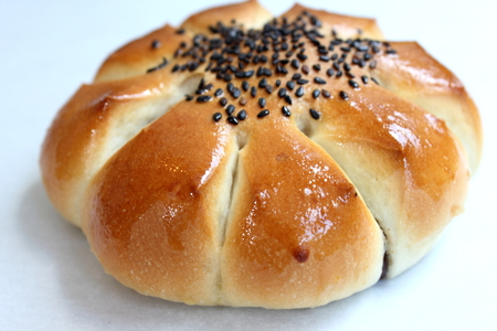 filled: Delicious red bean black sesame filled bun Stock Photo