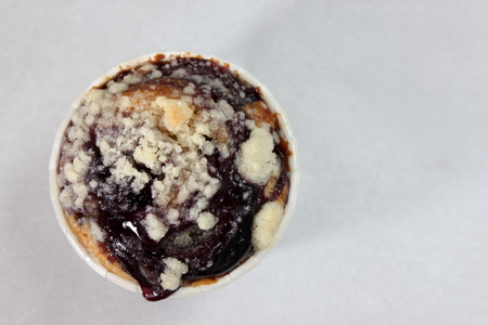 blueberry muffin: A Blueberry Muffin on  plate as close up.