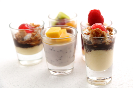 dessert table: Sweet desserts in the glass decorated with fruit