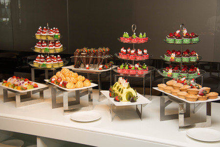 traditional events: Various dessert with fresh fruit on buffet line, sweet
