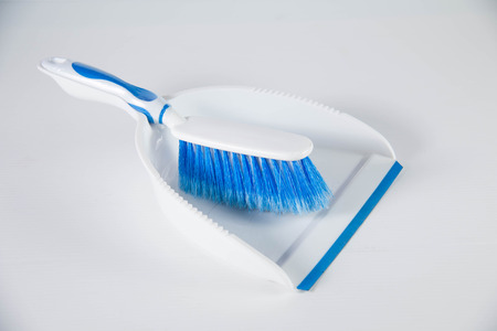 reciclar: Cleaning concept.Garbage bin, dustpan or scoop and brush