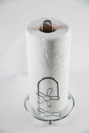 tissues: Roll of water absorbing tissues on a white background