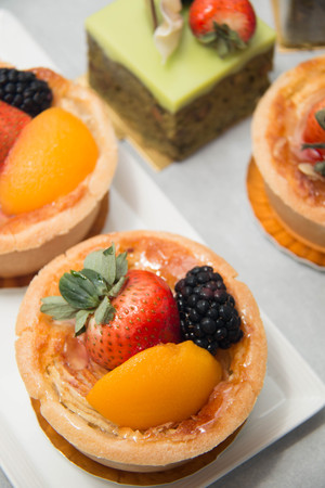 summer pudding: Fresh dessert fruit tart covered in assorted tropical fruits