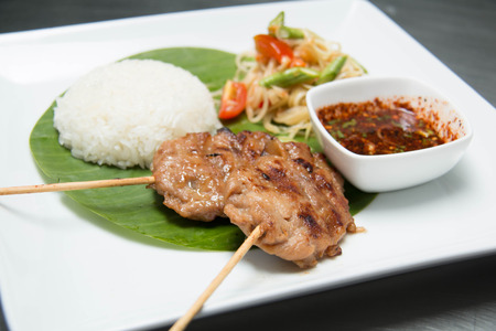 thai style: Grilled pork and sticky rice on plate, (Thai food style)