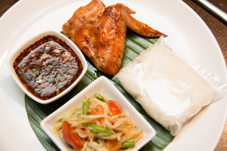 green papaya salad: A Green papaya salad, grilled chicken and sticky rice