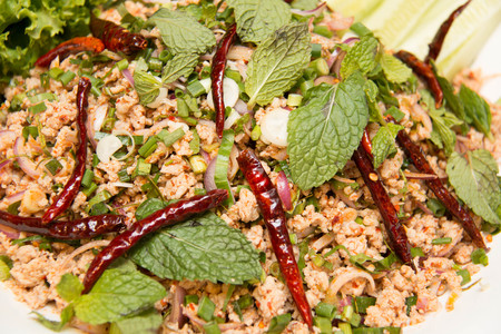 isaan: Thai food spicy minced chicken salad on plate
