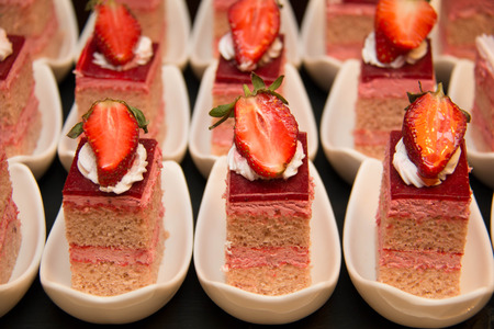 peice: A peice of strawberry cake as closeup on a white cup