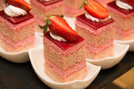 peice: A peice of strawberry cake as closeup on a white plate