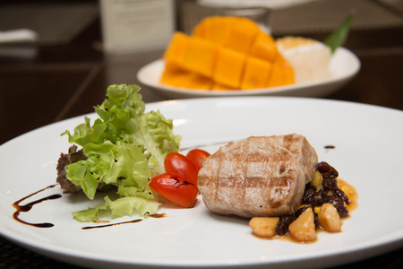 tenderloin: Grilled pork tenderloin  and served with mango sauce and salad