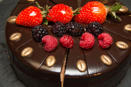 decorate: A Chocolate cake with strawberries on buffet Stock Photo