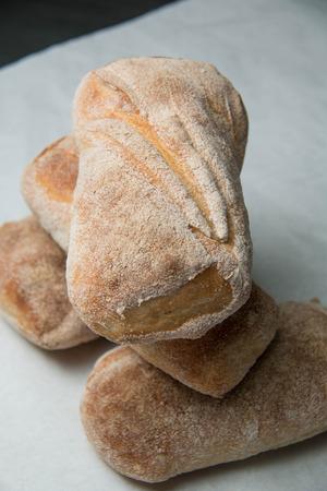 artisan bakery: Italian and Ciabatta loaves of bread  background