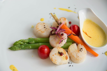 mage: mage of gourmet seared scallops with garnishes.