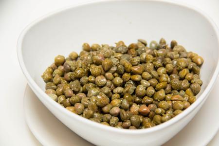 caper: A Pickled caper in Small white bowls