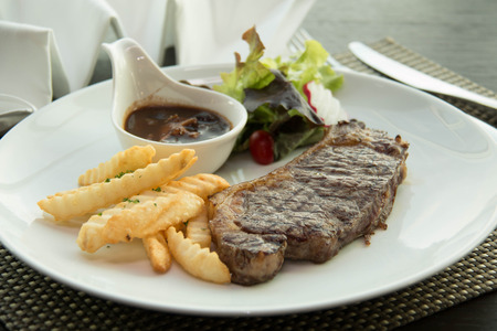 beefsteaks: Sirloin steak with Vegetables on the plate