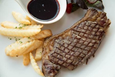 beefsteaks: Sirloin steak with potato on the plate