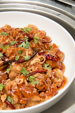sweet and sour: A Sweet sour chicken asian cuisine on dish Stock Photo