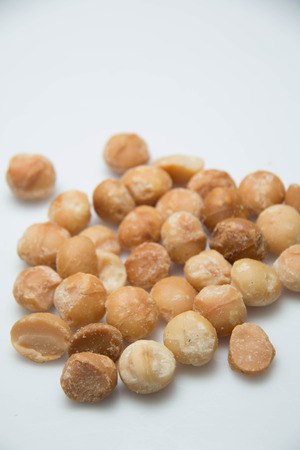 nutty: A Macadamia Nut in isolated white background