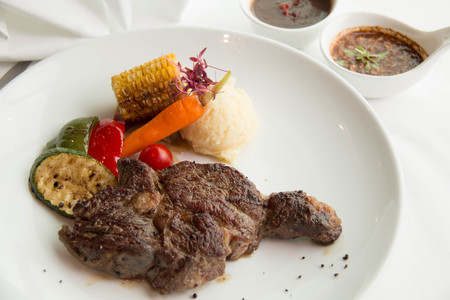 beefsteaks: Freshly cooked rare sirloin steak  on a white plate