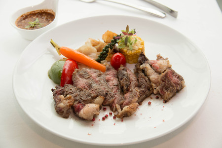 freshly cooked: Freshly cooked rare sirloin steak  on a white plate
