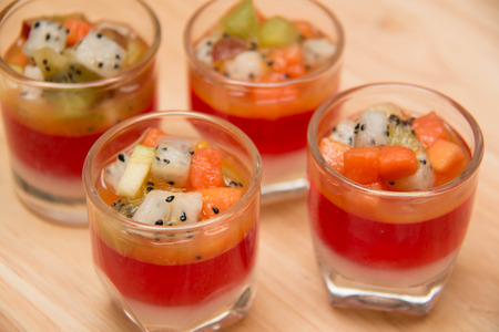 summer pudding: Jelly in the glass  top with fresh fruit and Stock Photo