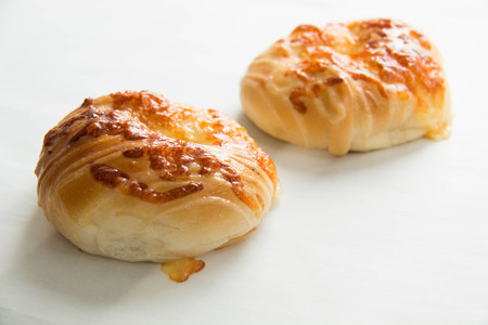 bake bread cheese on a white plate Stock Photo