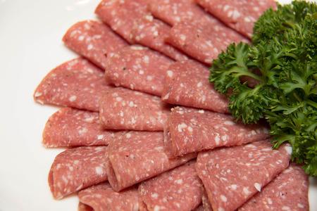 A Still life with sliced italian salami Stock Photo