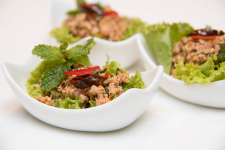 Larb Gai, spicy chicken,close up in small  cup Stock Photo