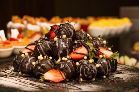 fresh strawberry dipping chocolate on buffet Stock Photo