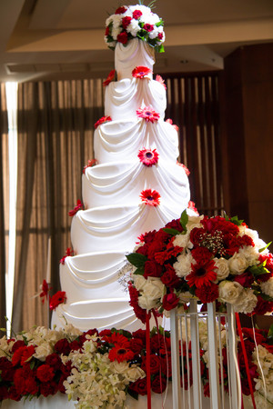 topper: A Wedding cake with flowers and seven tiers