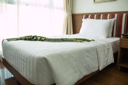 nightstands: A view of a comfortable, well-furnished hotel bedroom with nightstands