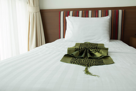 nightstands: A view of a comfortable, well-furnished hotel bedroom with nightstands   Stock Photo