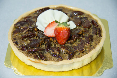 A nut pie on a pastry background