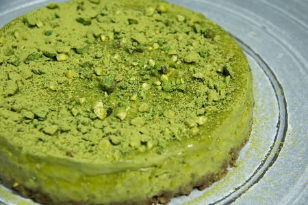 A Pistachio cake with macaroon  selective focus