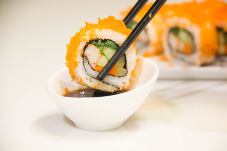 Egg imitation crabmeat cucumber roll sushi and chopsticks