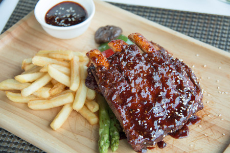 A pork bbq ribs, meaty ribs smothered with bbq sauce