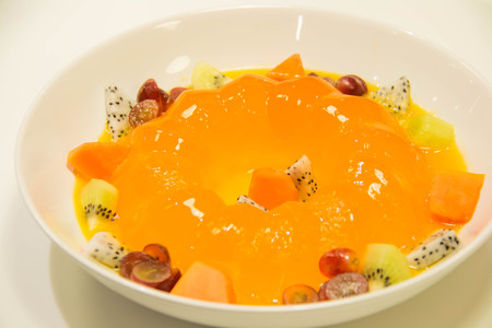 orange jelly with fresh fruit on plate