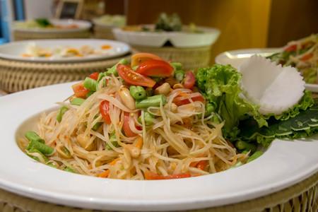 A delicious som tum Thai spicy salad