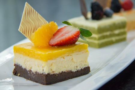 A delicious orang cheese cake Imagens