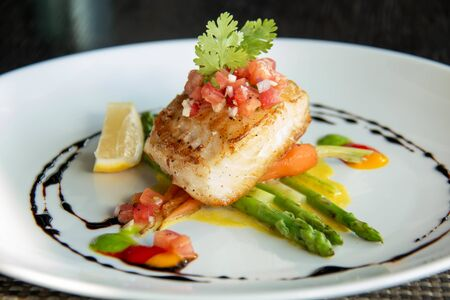 A delicious fish steak on white plate