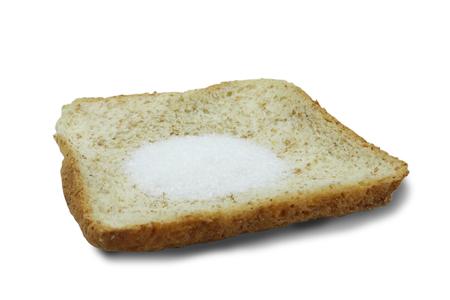 Monosodium glutamate (MSG) on slice breads isolated on white background.