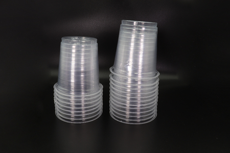 Lying and standing plastic cups isolated on black background. High resolution image gallery.
