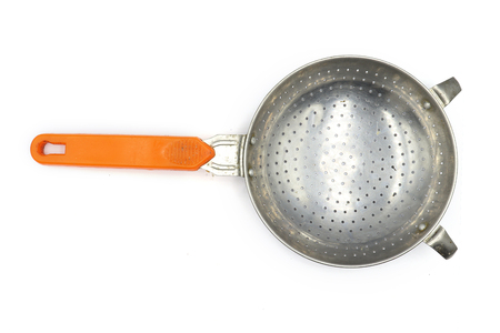 Colander, small colander , old colander , Colander with orange handle isolated on white background. High resolution image gallery. Reklamní fotografie