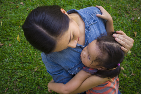 Young mother hugging and soothing a crying little daughter, Asian mother trying to comfort and calm down her crying child High resolution image gallery.